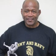 Wrestling Coach Roye Oliver Receives Coaches Award Trophy